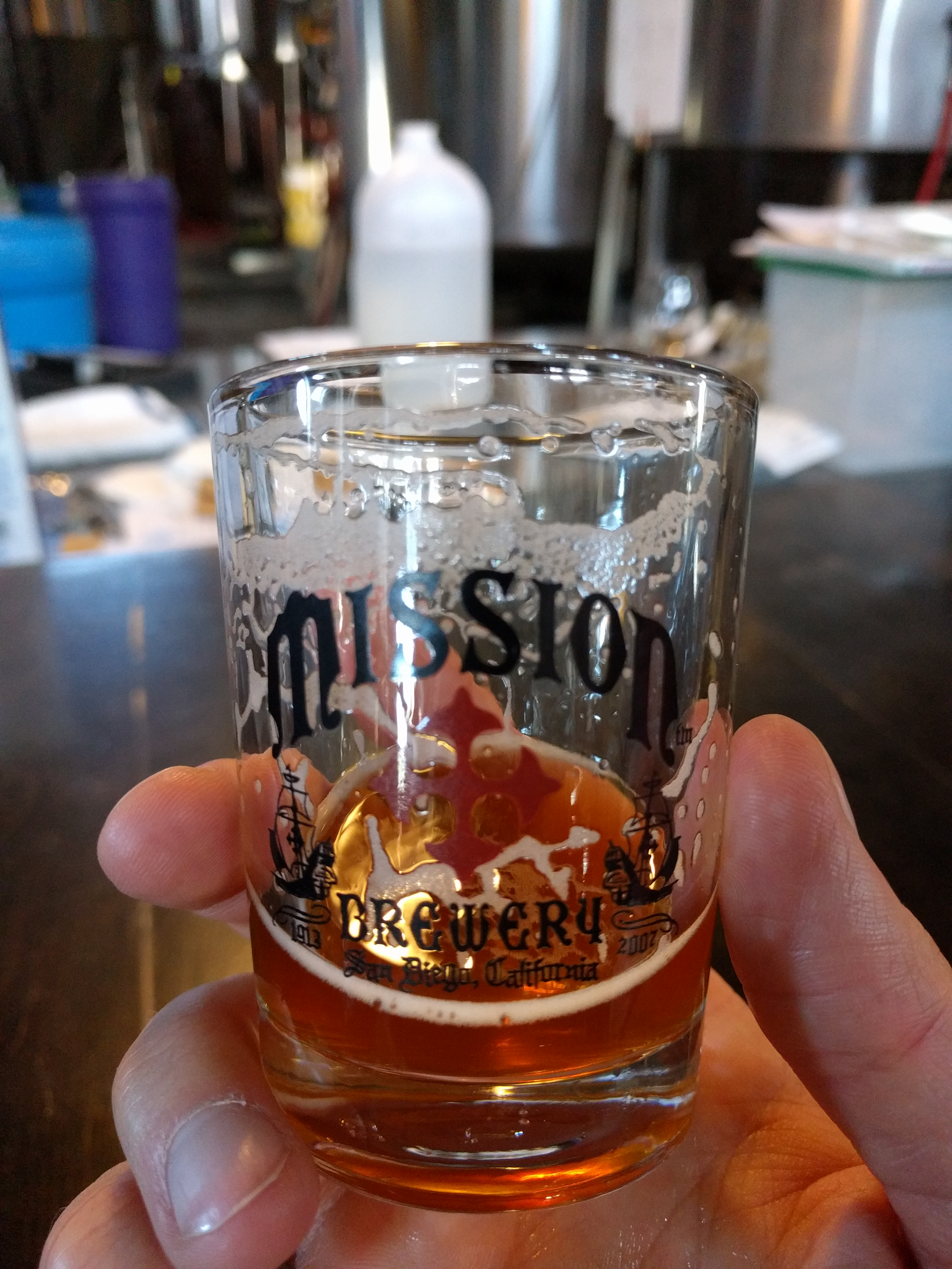 A taster in Mission Brewery San Diego