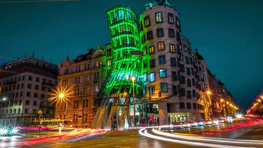 A timelapse photo of The Dancing House in Prague